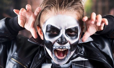 Boy Wearing Skull Makeup For Halloween