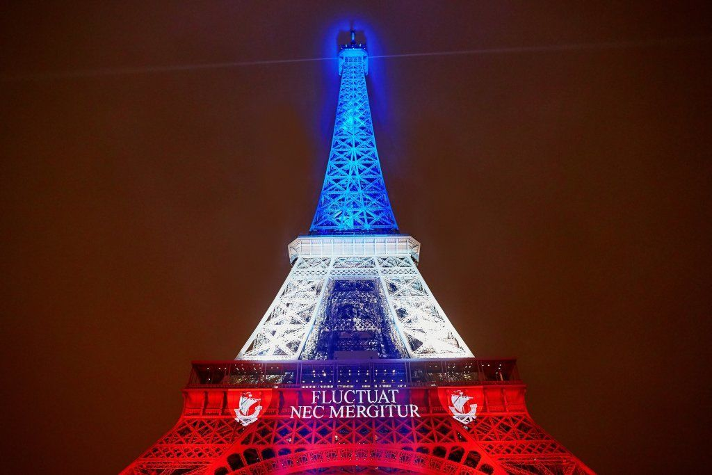 Eiffel Tower Illuminated With Colors Of The French National Flag