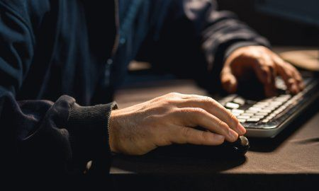 Photo Of Male Hacker Typing On Keyboard