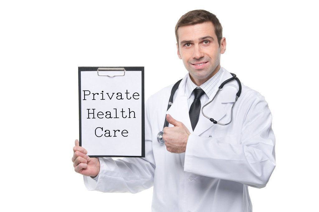 Male Doctor With Clipboard With Private Health Care