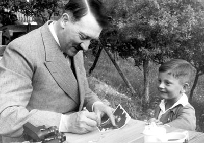 Hitler signing autograph