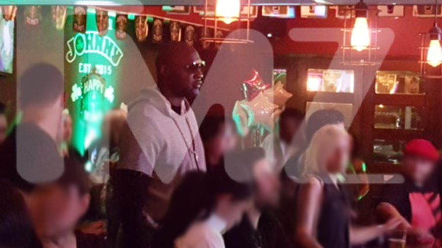 Lamar at a bar